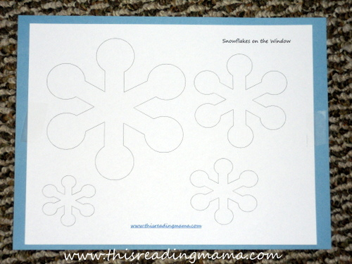 photo of snowflake poke pages with construction paper