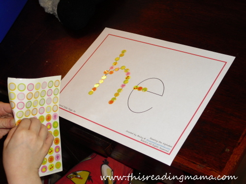 placing stickers on letters to form a word, fine motor | This Reading Mama