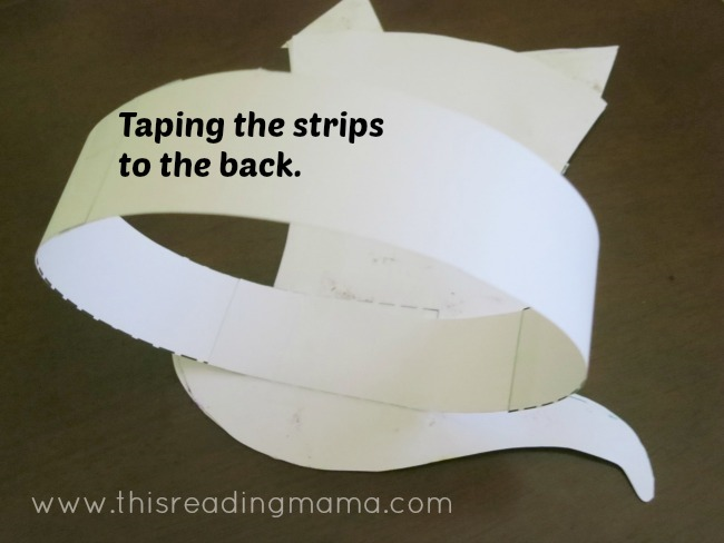 taping strips on the back of hat