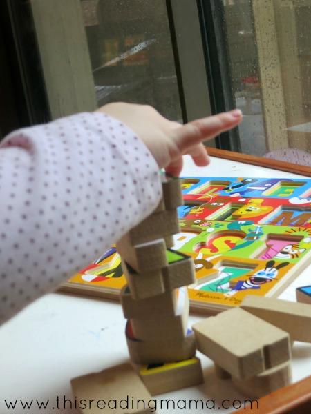 stacking alphabet puzzle pieces