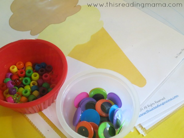 adding pony beads and googly eyes to playdough play