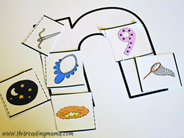 gluing down alphabet picture cards on letters