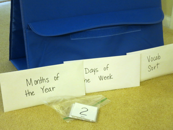 storing the calendar vocabulary cards in back of the pocket chart