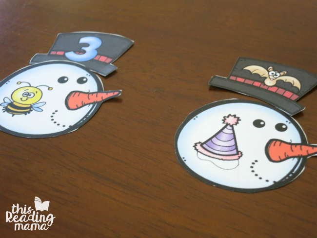 matching rhyming snowman heads to hats