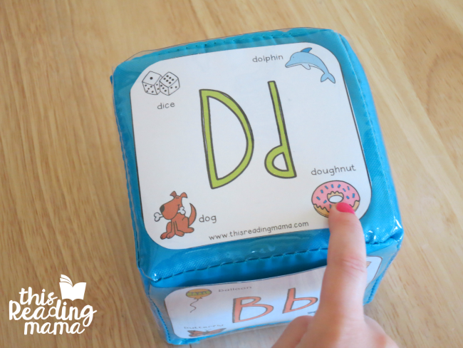 roll the alphabet phonics cube and identify the letter and letter sound